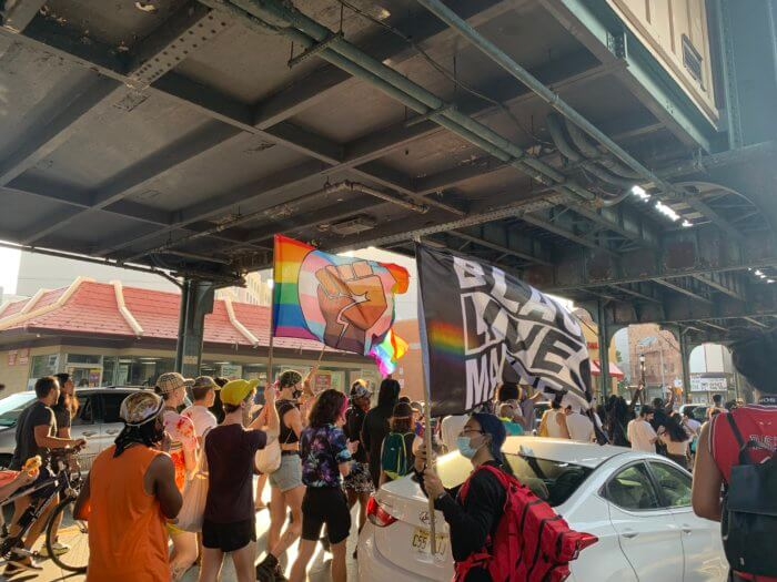 People march down Broadway protesting anti-gay attacks